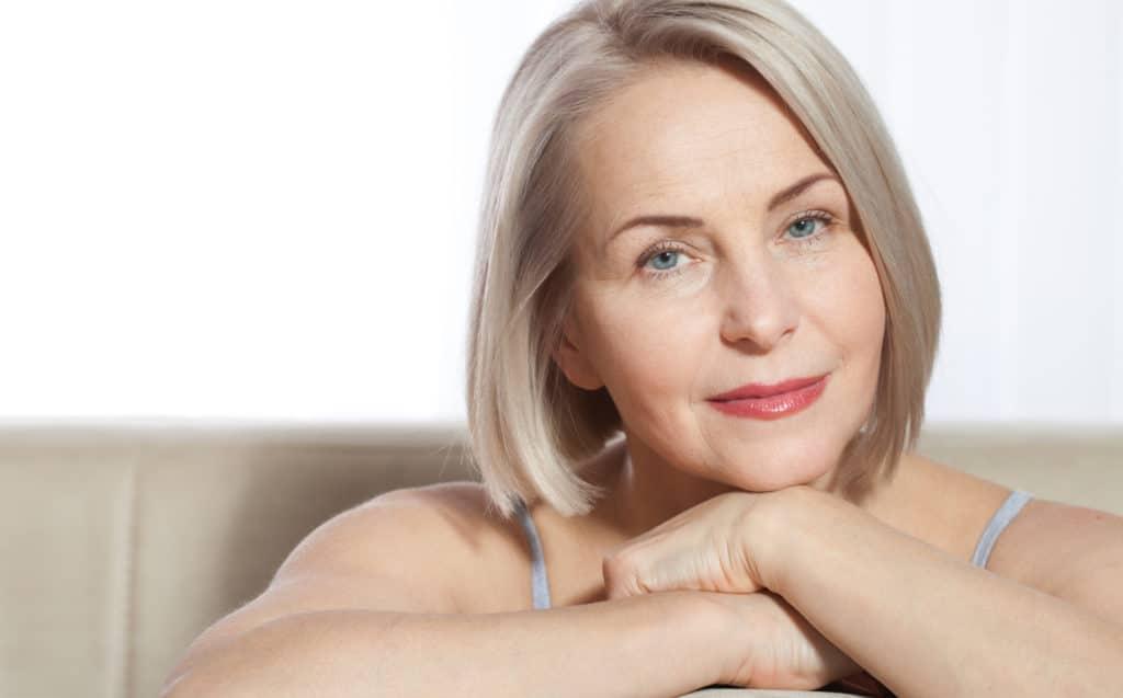 A portrait image of a middle-aged Caucasian woman